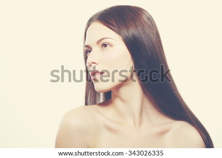 Beautiful face of young woman with clean fresh skin - retro toning
