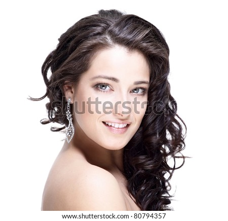 Beautiful face of young woman with clean skin - stock photo