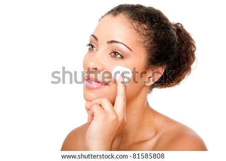 Beautiful face of young woman with hand applying exfoliating anti wrinkle moisturizing cream beauty treatment for skincare, isolated. - stock photo