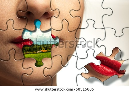 Beautiful face of young woman with puzzle pieces. Landscape with blue sky on a place of lips. - stock photo
