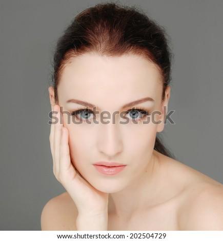 beautiful face portrait-gray background  - stock photo