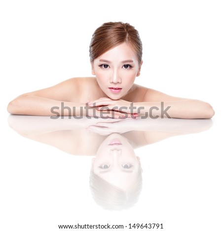 Beautiful face skincare beauty woman lying down with mirror reflection isolated on white background. asian beauty model - stock photo
