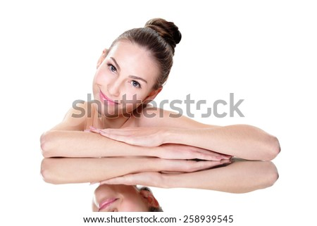 Beautiful face skincare beauty woman lying down with mirror reflection isolated on white background. caucasian - stock photo
