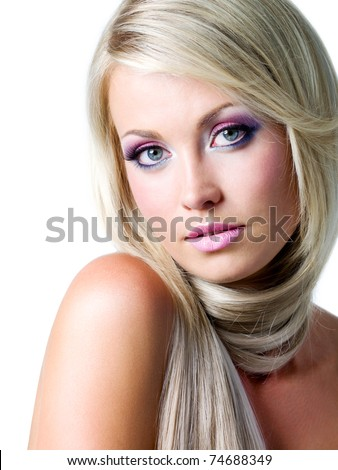 Beautiful face with bright colors of make-up and straight long hair - stock photo