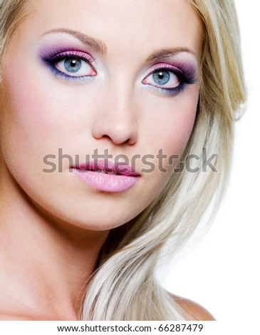 Beautiful face with bright make-up and straight long hair - stock photo