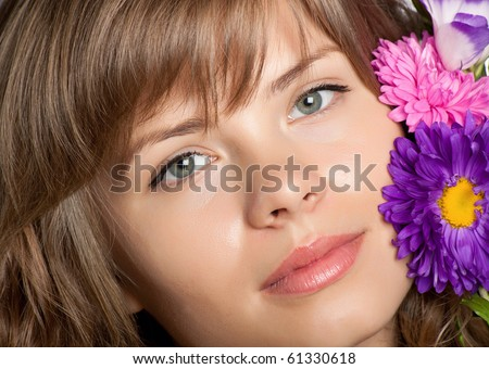 Beautiful face with flower on it - stock photo
