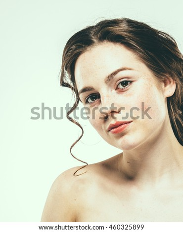 Beautiful face woman freckles and curly fly hair nice smile portrait