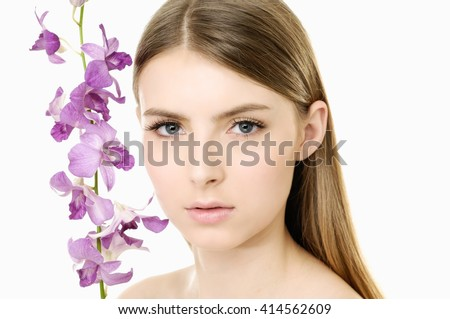 beautiful face young woman and pink orchid