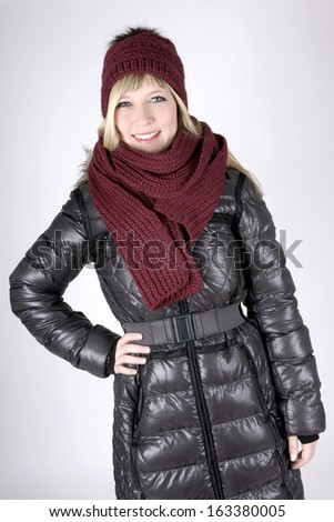 Beautiful fair haired young woman in winter clothes - stock photo