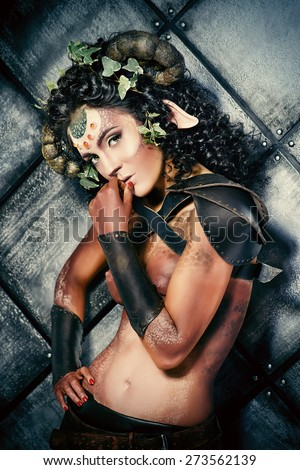 Beautiful fairy female Faun. Myth and fantasy. Body painting project. - stock photo
