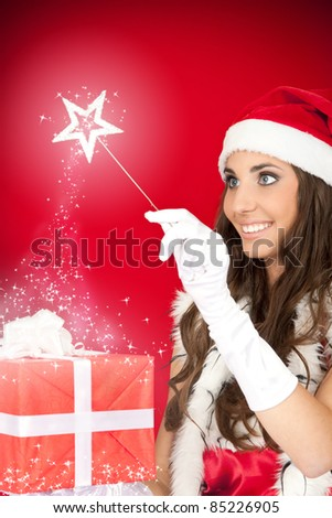 beautiful fairy with magic wand and Christmas present - stock photo