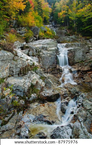 Beautiful fall foliage at the Flume Cascade. Crawford Notch State Park, White Mountains, New Hampshire - stock photo