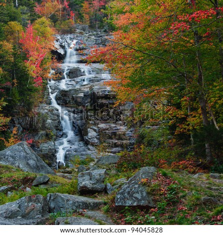 Beautiful fall foliage at the Silver Cascade. Crawford Notch State Park, White Mountains, New Hampshire