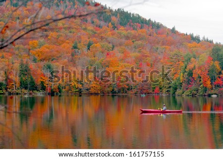 Beautiful fall landscape with  lake and mountains - stock photo