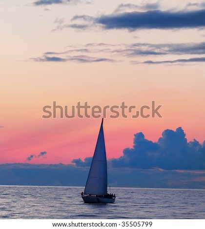 Beautiful fall sunset and yacht in ocean