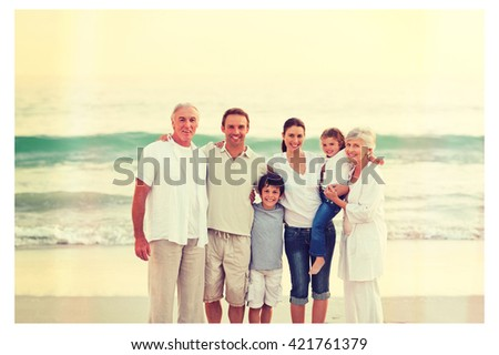 Beautiful family at the beach - stock photo
