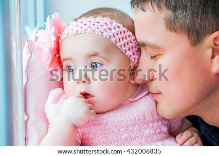 Beautiful family closeup. Father kissing newborn daughter girl. Happy baby childhood. Background, closeup, macro - stock photo