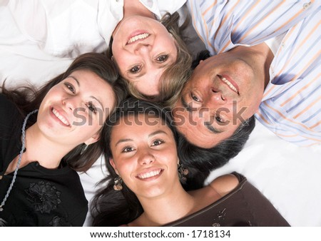 beautiful family - heads together on the floor