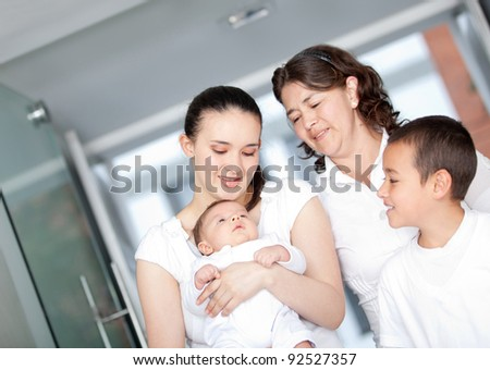 Beautiful family holding a cute newborn leaving the hospital
