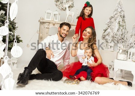 Beautiful Family in Christmas Scenery - stock photo