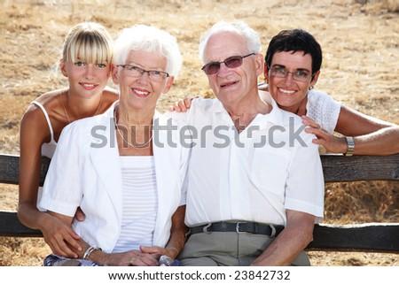 beautiful family of four - family lifestyle portrait - stock photo