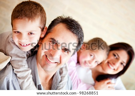 Beautiful family portrait sitting at home and smiling
