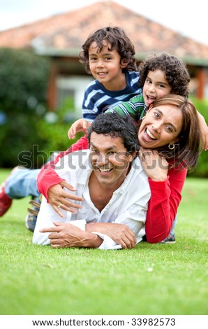 Beautiful family portrait smiling and having fun outdoors - stock photo