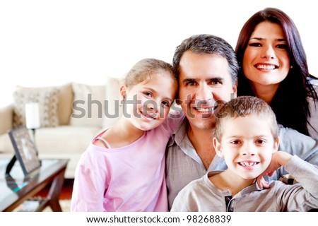 Beautiful family portrait smiling at home and looking happy - stock photo