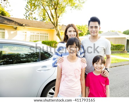 Beautiful family portrait smiling outside their  house - stock photo