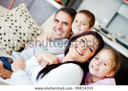 Beautiful family portrait spending time together at home - stock photo