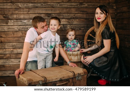 Beautiful family portrait spending time together at studio