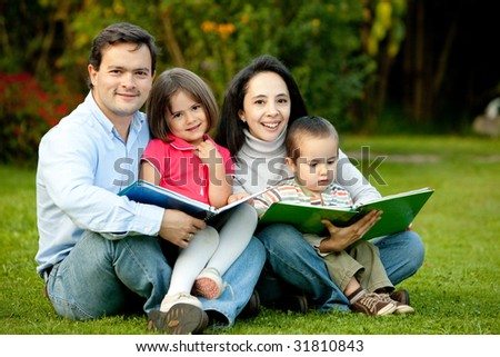 Beautiful family portrait with some notebooks outdoors