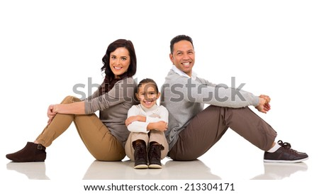 beautiful family sitting on the floor isolated on white - stock photo