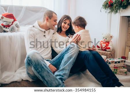 Beautiful family waiting for Christmas - stock photo