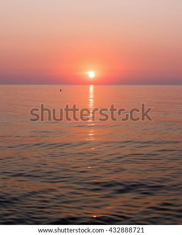 Beautiful fascinate morning sea view with sunrise and sun track on surface.