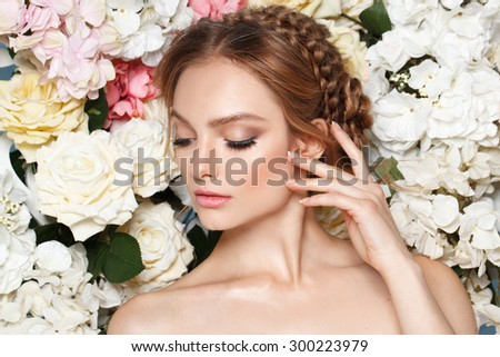 Beautiful fashion bride, sweet and sensual. Wedding make up and blonde hair. Flowers background. Art modern style. Blue eyes - stock photo