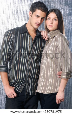 beautiful fashion couple shot in studio - stock photo