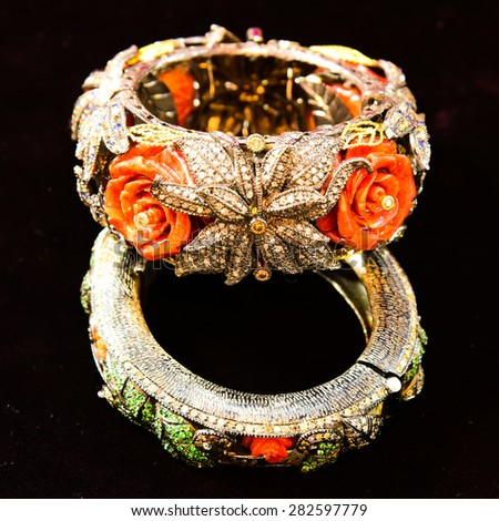 beautiful fashion expensive bracelet design on black background - stock photo