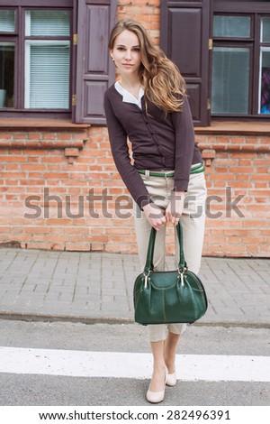 Beautiful fashion girl in a city - stock photo