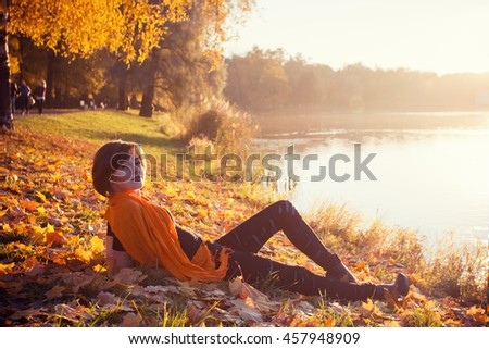 Beautiful fashion girl in autumn park - stock photo