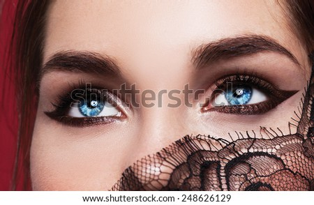 Beautiful fashion girl with arrow make up. Closeup female eye with beautiful fashion bright  makeup.  - stock photo
