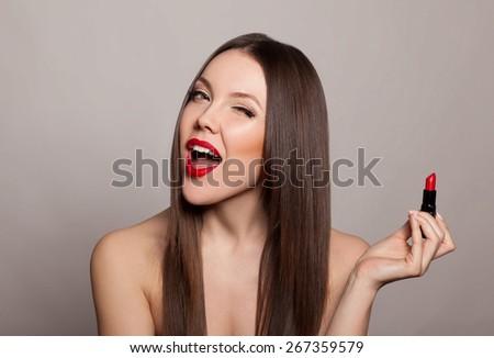 Beautiful fashion girl with red lipstick - stock photo