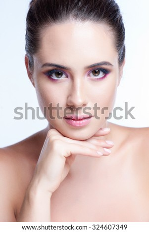 Beautiful Fashion Luxury Makeup. Beauty Brunette model woman holiday make up close up.  - stock photo