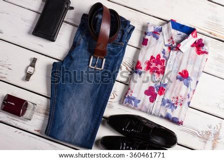 Beautiful fashion men's clothing on a white wooden background. Stylish men's set of wear. - stock photo
