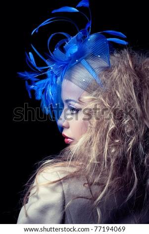 Beautiful fashion mode wearing blue hat, classic retro style look, studio portrait - stock photo