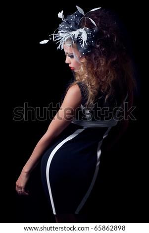 Beautiful fashion model, classic retro style look, isolated on black - stock photo