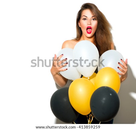 Beautiful fashion model girl with colorful balloons posing isolated on white background. Beauty surprised funny girl. Model holiday selebrating, posing in studio with balloons. Holiday party concept - stock photo