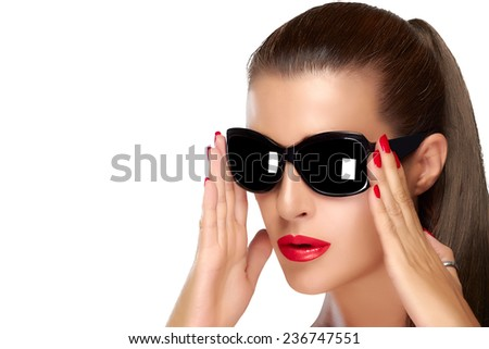 Beautiful fashion model girl with stylish over sized black sunglasses. Bright makeup and manicure. High fashion portrait isolated on white background with copy space. Beauty and fashion concept.