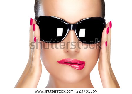 Beautiful fashion model girl with stylish oversized black sunglasses. Bright makeup and manicure. High fashion portrait isolated on white background. Beauty and fashion concept.