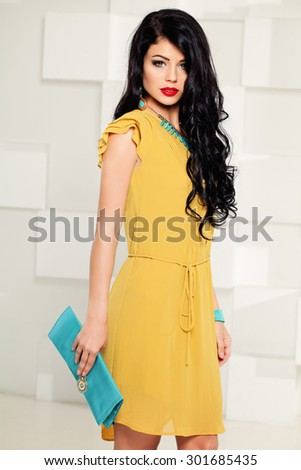 Beautiful Fashion Model Girl. Woman with Curly Dark Hair - stock photo
